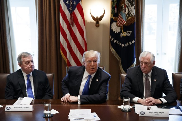 in-this-jan-9-2017-photo-sen-dick-durbin-d-ill-left-and-rep-steny-hoyer-d-md-listen-as-president-donald-trump-speaks-during-a-meeting-with-lawmakers-on-immigration-policy-in-the-cabinet-room-of-the-white-house-in-washington-bargainers-seeking-a-bipartisan-immigration-accord-planned-talks-as-soon-as-wednesday-as-president-donald-trump-and-leading-lawmakers-sought-to-parlay-an-extraordinary-white-house-meeting-into-momentum-for-resolving-a-politically-blistering-issue