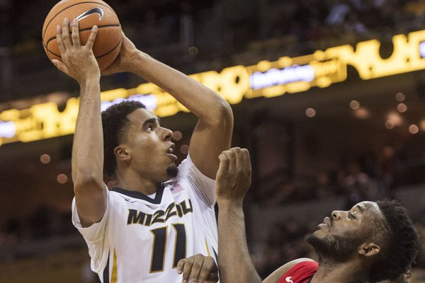 Missouri's Jontay Porter, left, shoots over Georgia's Yante Maten during the second half of an NCAA college basketball game Wednesday, Jan. 10, 2018, in Columbia, Mo. Missouri won 68-56. (AP Photo/L.G. Patterson)