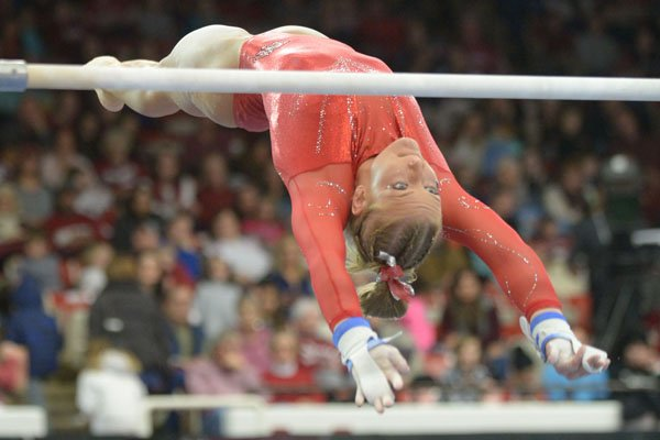 Arkansas' Sarah Shaffer competes Friday, Jan. 12, 2018, in the bars portion of the 11th-ranked Razorbacks' meet with sixth-ranked Kentucky in Barnhill Arena in Fayetteville.