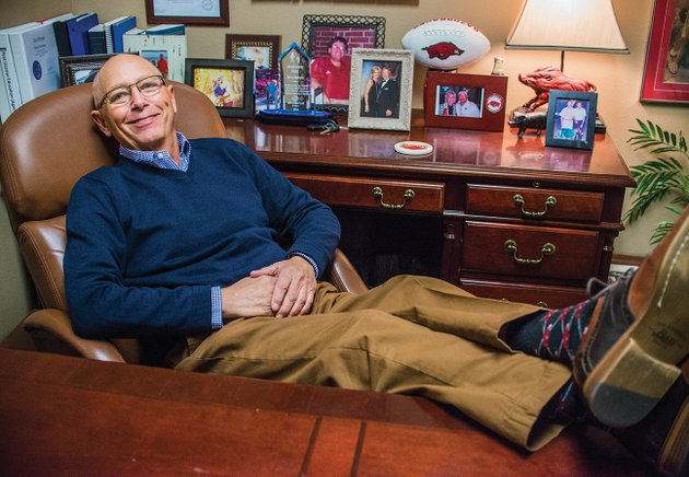 bryant-city-councilman-jerry-henson-shows-off-his-arkansas-razorback-socks-in-his-office-at-old-south-realty-in-benton-henson-who-was-diagnosed-with-stage-4-liver-cancer-a-month-ago-was-presented-with-the-charles-broadway-community-excellence-award-on-dec-19