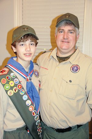 Trey Moody, left, is pictured with his father, Lackey Moody. Trey received his Eagle Scout rank in December, two days before his 14th birthday, which was Dec. 19. Moody's project was building a flag-retirement pit in Riverside Park in Batesville.