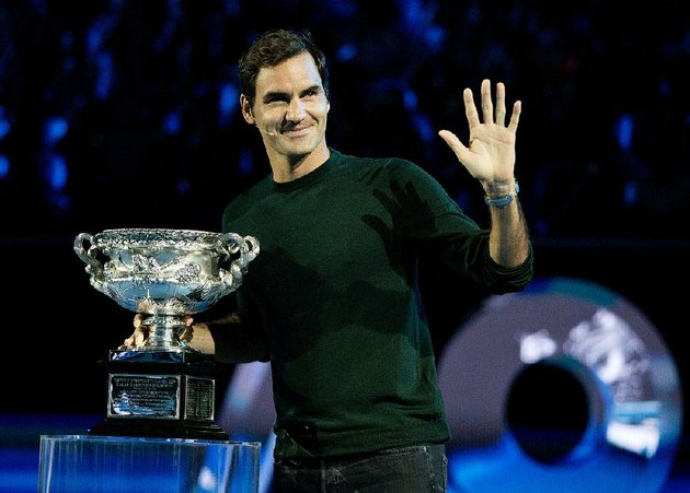 defending-mens-singles-champion-switzerlands-roger-federer-waves-to-the-crowd-during-a-ceremony-for-the-official-draw-at-the-australian-open-tennis-championships-in-melbourne-australia-thursday-jan-11-2018