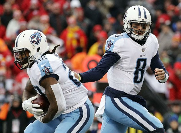 tennessee-titans-quarterback-marcus-mariota-right-hands-off-to-running-back-derrick-henry-last-week-against-the-kansas-city-chiefs-the-titans-won-22-21-to-advance-to-a-divisional-round-matchup-tonight-against-the-new-england-patriots