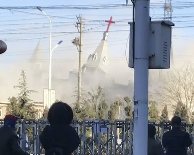 people-watch-as-paramilitary-troops-use-excavators-and-dynamite-to-demolish-golden-lampstand-church-in-linfen-in-northern-chinas-shanxi-province-the-church-was-one-of-two-razed-in-recent-weeks