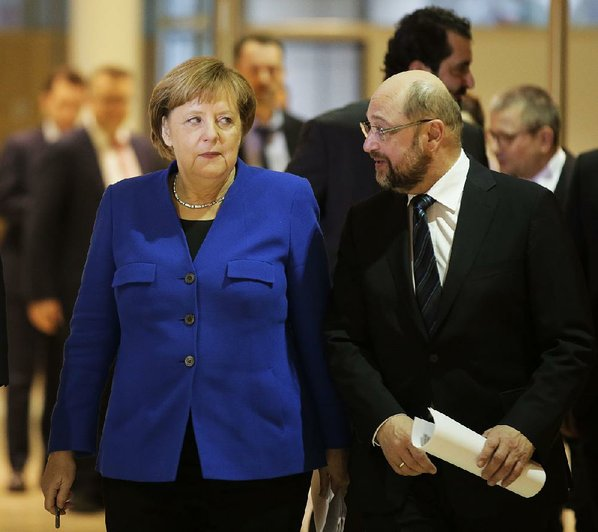 New German parliament to cap refugee inflow & scrap tax hike - coalition roadmap