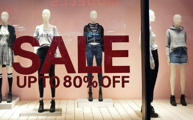 an-hm-store-window-advertises-a-sale-at-a-mall-in-new-york-city-consumer-inflation-rose-just-01-percent-in-december-the-smallest-gain-since-october