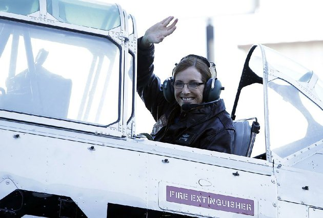 us-rep-martha-mcsally-r-ariz-waves-from-a-world-war-ii-era-t-6-airplane-friday-at-a-stop-in-tucson-as-she-starts-her-campaign-to-replace-sen-jeff-flake