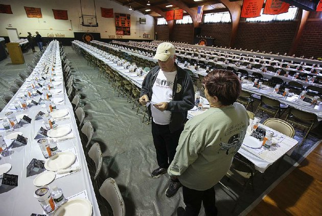 jon-howell-left-and-christy-murphy-set-up-tables-and-chairs-friday-at-the-gym-in-gillett-as-the-town-gets-ready-for-the-75th-annual-coon-supper