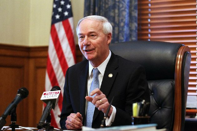 governor-asa-hutchinson-left-talks-about-shrinking-medicare-costs-on-thursday-jan-4-2018-at-the-state-capitol-in-little-rock