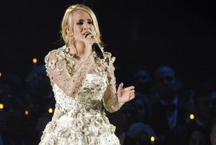 """FILE - In this Wednesday, Nov. 8, 2017, file photo, Carrie Underwood performs """"Softly and Tenderly"""" during an In Memoriam tribute at the 51st annual CMA Awards at the Bridgestone Arena in Nashville, Tenn. Underwood teamed up with Ludacris to co-write a new song """"The Champion,"""" which will be the opening video for the Super Bowl on Feb. 4 airing on NBC. The song, which was also written by country songwriters Brett James and Chris DeStefano, was released Friday, Jan. 12, 2018. (Photo by Chris Pizzello/Invision/AP, File"""