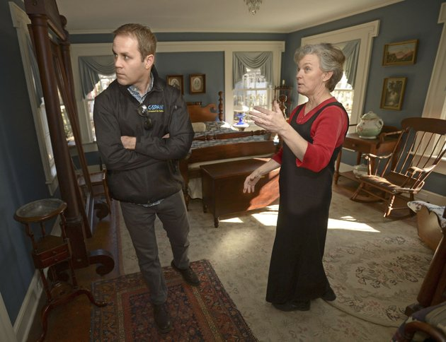 scott-hummelsheim-left-a-producer-and-video-journalist-with-c-span-speaks-wednesday-with-judy-costello-director-of-historical-programs-for-the-washington-county-historical-society-while-preparing-to-film-a-segment-about-fayetteville-at-headquarters-house