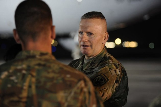 us-army-command-sgt-maj-john-wayne-troxell-the-senior-enlisted-adviser-to-gen-joseph-f-dunford-the-chairman-of-the-joint-chiefs-of-staff-speaks-on-the-flightline-of-al-dhafra-air-base-in-the-united-arab-emirates-on-dec-22