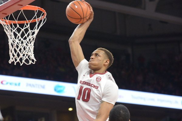 Daniel Gafford goes in for a dunk during a game against Missouri on Saturday, Jan. 13, 2018, in Fayetteville.