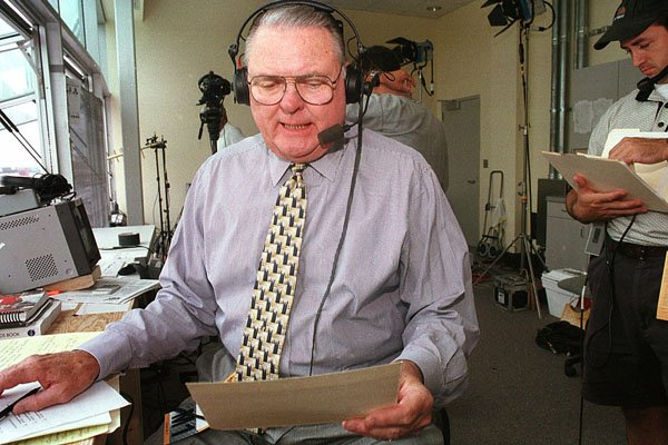 ABC television sports commentator Keith Jackson reads through a checklist prior to the Nebraska-California football game Saturday, Sept. 11, 1999 in Lincoln, Neb. (AP Photo/S.E. McKee)