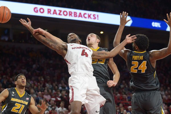 Arkansas guard Daryl Macon (4) goes for a loose ball during a game against Missouri on Saturday, Jan. 13, 2018, in Fayetteville.