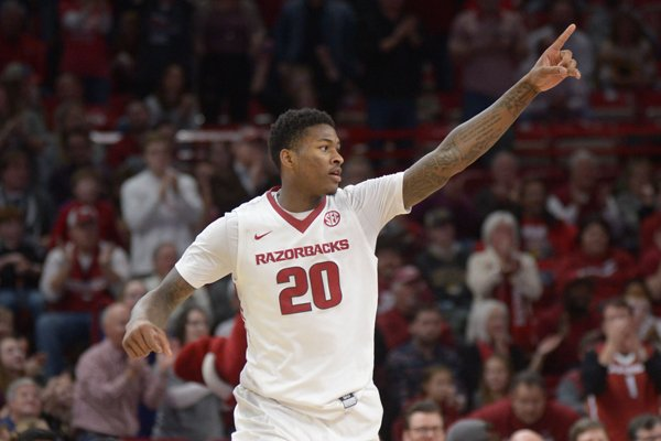 Arkansas forward Darious Hall points to the crowd during a game against Missouri on Saturday, Jan. 13, 2018, in Fayetteville.