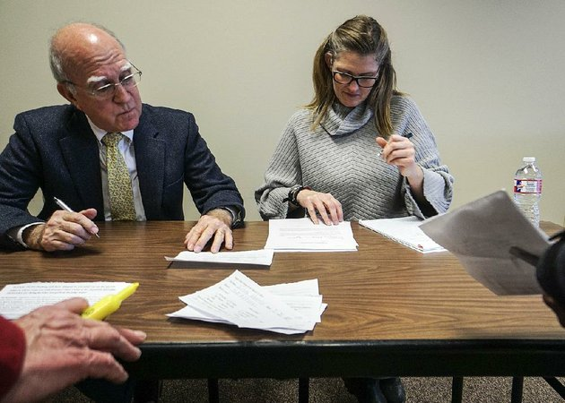 little-rock-district-judge-vic-fleming-and-senior-probation-officer-jennifer-cummings-go-over-paperwork-saturday-during-leniency-court-at-the-rights-after-wrongs-event-in-little-rock