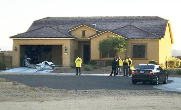 file-this-oct-2-2017-file-photo-provided-by-the-mesquite-nev-police-department-shows-police-personnel-stand-outside-the-home-of-stephen-paddock-on-monday-oct-2-2017-in-mesquite-a-federal-judge-is-being-asked-to-unseal-documents-telling-what-federal-agents-learned-before-searching-properties-belonging-to-the-gunman-responsible-for-the-oct-1-2017-massacre-on-the-las-vegas-strip-prosecutors-arent-opposing-a-friday-jan-12-2018-request-from-media-organizations-for-us-district-judge-jennifer-dorsey-to-release-redacted-affidavits-underlying-warrants-for-locations-including-stephen-paddocks-home-in-mesquite-mesquite-police-department-via-ap-file