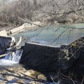 The Pump Station dam on the West Fork of the White River is seen Wednesday near Pump Station Road an...