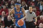KeVaughn Allen (5) of the Florida Gators drives up the court against Arkansas Thursday Dec. 29, 2016 at Bud Walton Arena in Fayetteville.