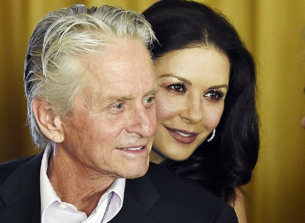 Zeta-Jones defends hubby over harassment claims