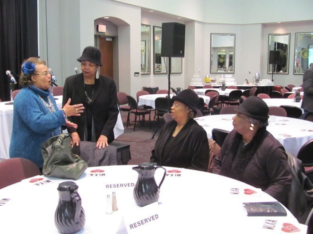 former-northside-high-school-teacher-rhonda-vanlue-gray-left-welcomes-the-three-civil-rights-icons-known-as-the-mcdonogh-3-from-second-lefttessie-prevost-williams-gail-etienne-stripling-and-leona-tate-at-a-martin-luther-king-jr-commemorative-celebration-monday-at-the-university-of-arkansas-at-fort-smith-also-attending-the-celebration-was-louie-mckinney-the-first-career-deputy-us-marshal-to-lead-the-us-marshals-service-gray-was-on-a-panel-discussing-the-integration-of-fort-smith-northside-high-school-in-the-1960s