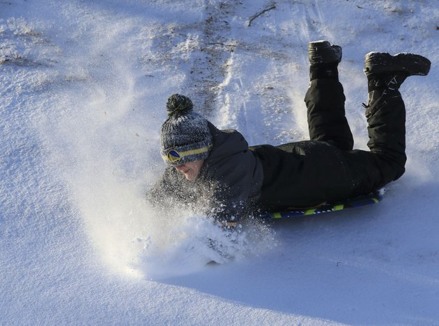 john-carter-tafner-9-sleds-down-a-hill-tuesday-morning-at-the-clinton-presidential-library-park