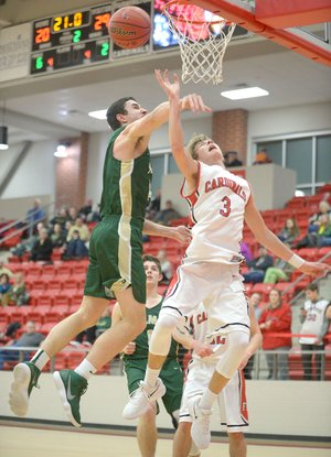NWA Democrat-Gazette/ANDY SHUPE Alma's Kade Wood (left) fouls Farmington's Peyton Maxwell (3) at the rim Tuesday at Cardinal Arena in Farmington. Visit nwadg.com/photos for more photos from the game.