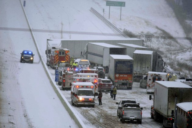 emergency-personnel-remove-patients-for-transport-to-area-hospitals-at-the-scene-of-a-multi-vehicle-wreck-on-interstate-65-near-bonnieville-ky-on-tuesday-jan-16-2018