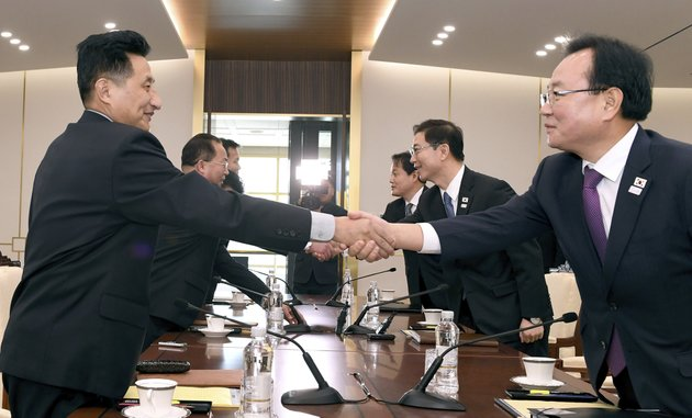 in-this-photo-provided-by-south-korea-unification-ministry-south-korean-vice-unification-minister-chun-hae-sung-center-right-shakes-hands-with-the-head-of-north-korean-delegation-jon-jong-su-during-their-meeting-at-panmunjom-in-the-demilitarized-zone-in-paju-south-korea-wednesday-jan-17-2018-the-two-koreas-are-meeting-wednesday-for-the-third-time-in-about-10-days-to-continue-their-discussions-on-olympics-cooperation-days-ahead-of-talks-with-the-ioc-on-north-korean-participation-in-the-upcoming-winter-games-in-the-south-south-korea-unification-ministry-via-ap
