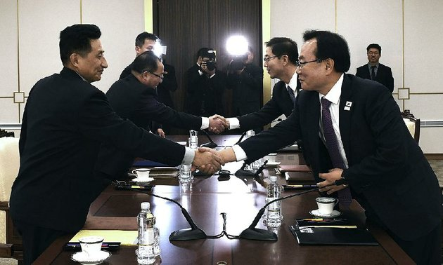 north-korean-officials-left-shake-hands-with-south-korean-unification-ministry-officials-wednesday-in-the-border-village-of-panmunjom-after-reaching-agreement-to-field-a-unified-olympic-team-with-their-athletes-parading-together-when-the-games-open-next-month-at-pyeongchang-south-korea