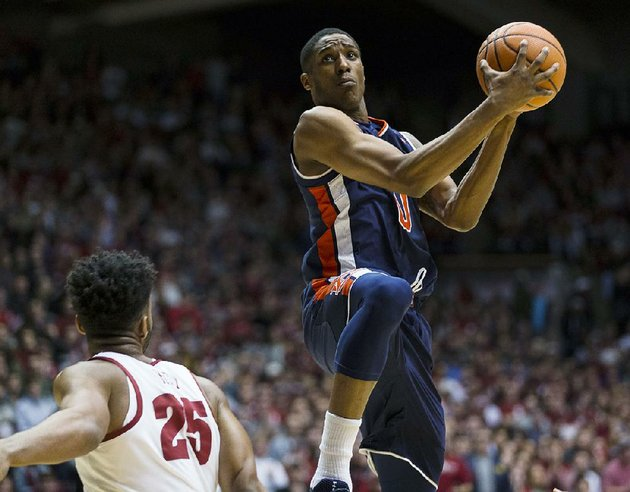 auburns-horace-spencer-shoots-over-alabamas-braxton-key-in-the-tigers-76-71-loss-wednesday-night-in-coleman-coliseum-in-tuscaloosa-ala