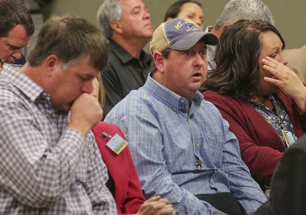 jason-henson-left-and-phillip-campbell-co-owners-of-ch-hog-farms-along-with-richard-campbell-listen-wednesday-as-the-arkansas-pollution-control-and-ecology-commission-gives-its-decision