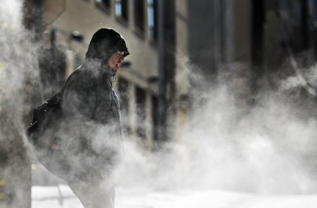 a-man-walks-through-steam-venting-from-a-building-in-the-cold-weather-in-atlanta-wednesday-jan-17-2018-the-south-awoke-on-wednesday-to-a-two-part-arctic-mess-first-came-a-thin-blanket-of-snow-and-ice-and-then-came-the-below-zero-wind-chills-and-record-breaking-low-temperatures-in-new-orleans-and-other-cities-ap-photodavid-goldman