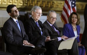 House Speaker Paul Ryan of Wis., Senate Majority Leader Mitch McConnell of Ky., Senate Minority Leader Chuck Schumer of N.Y., and House Minority Leader Nancy Pelosi of Calif., attend a Congressional Gold Medal ceremony honoring former Senator Bob Dole on Capitol Hill, Wednesday, Jan. 17, 2018, in Washington. (AP Photo/Evan Vucci)