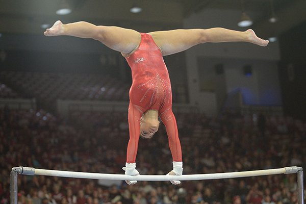 Arkansas' Sophia Carter competes Friday, Jan. 12, 2018, in the bars portion of the 11th-ranked Razorbacks' meet with sixth-ranked Kentucky in Barnhill Arena in Fayetteville.