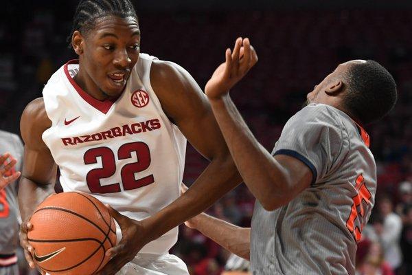 Arkansas' Gabe Osabuohien looks for room while Bucknell's Nate Jones defends Sunday Nov. 12, 2017 at Bud Walton Arena in Fayetteville.