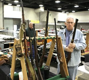 J.M. Harbet sets up one of over 110 vendor booths at the Hot Springs Convention Center in preparation for the Semi-Annual South Hot Springs Lions Club Gun and Knife Show Friday, Jnaury 19, 2018. The show opens Saturday from 9 a.m. to 5 p.m. and again Sunday from 9am to 4 p.m. (The Senintel-Record/Richard Rasmussen)