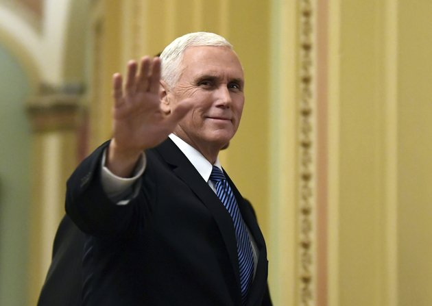 in-this-jan-3-2018-file-photo-vice-president-mike-pence-waves-as-he-walks-on-capitol-hill-in-washington