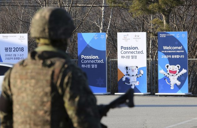 posters-showing-the-2018-pyeongchang-winter-olympic-mascot-are-displayed-as-a-south-korean-army-soldier-stands-guard-at-the-unification-observation-post-in-goseong-near-the-border-with-north-korea-south-korea-friday-jan-19-2018-the-rival-koreas-agreed-wednesday-to-form-their-first-unified-olympic-team-and-have-their-athletes-parade-together-for-the-first-time-in-11-years-during-the-opening-ceremony-of-next-months-winter-olympics-in-south-korea-officials-said