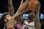Arkansas guard Jaylen Barford drives against Ole Miss defenders during a game Saturday, Jan. 20, 2018, in Fayetteville.