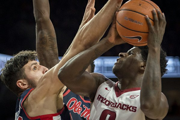 Barford scores 23 as Arkansas holds off Ole Miss, 97-93