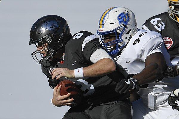 American team's Aaron Tiller, right, of Southern, sacks National team quarterback Austin Allen, of Arkansas, during the first half of the Collegiate Bowl college football game, Saturday, Jan. 20, 2018, in Pasadena, Calif. (AP Photo/Mark J. Terrill)