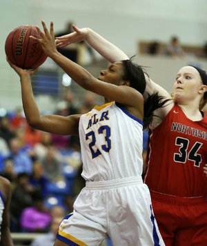 North Little Rock's Kennady Tucker (23) puts up a shot as Fort Smith Northside's Tracey Bershers defends during the fourth overtime of North Little Rock's 80-75, five-overtime victory Friday night.