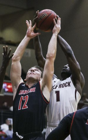 Arkansas State's Connor Kern (12) finished with 8 points in the Red Wolves' 70-62 victory over UALR, while Andre Jones had 11 points and 9 rebounds for UALR.