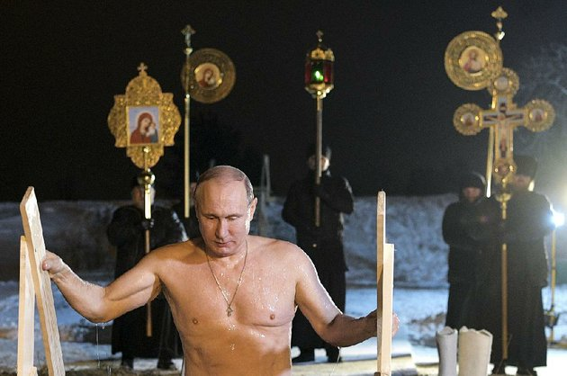 russian-president-vladimir-putin-bathes-in-ice-cold-water-on-epiphany-neat-st-nilus-stolobensky-monastery-on-lake-seliger-in-svetlitsa-village-russia-friday-jan-19-2018-thousands-of-russian-orthodox-church-followers-will-plunge-into-icy-rivers-and-ponds-across-the-country-to-mark-epiphany-cleansing-themselves-with-water-deemed-holy-for-the-day