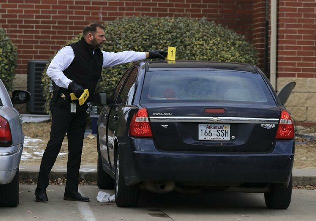 a-pulaski-county-sheriffs-official-gathers-evidence-friday-morning-after-a-fatal-shooting-at-fairfax-crossing-apartments-it-was-the-second-homicide-at-the-complex-in-less-than-four-months