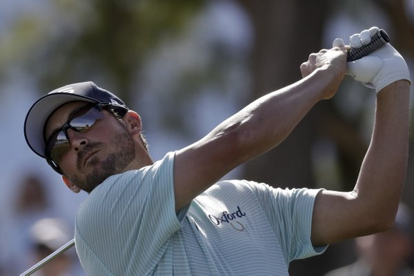 Andrew Landry watches his tee shot on the sixth hole during the final round of the CareerBuilder Challenge golf tournament on the Stadium Course at PGA West Sunday, Jan. 21, 2018 in La Quinta, Calif.