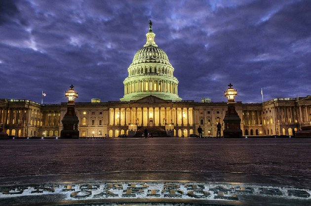lights-shine-inside-the-us-capitol-as-night-falls-sunday-in-washington-and-as-congress-continues-to-negotiate-during-the-second-day-of-the-federal-government-shutdown