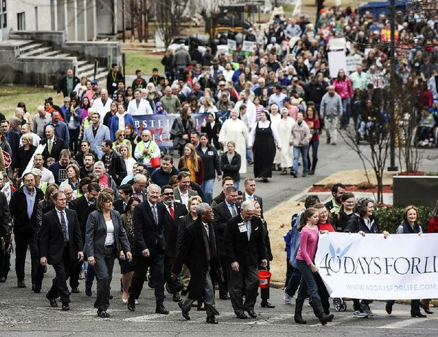 people-take-part-in-the-march-for-life-on-the-grounds-of-the-state-capitol-in-little-rock-on-sunday